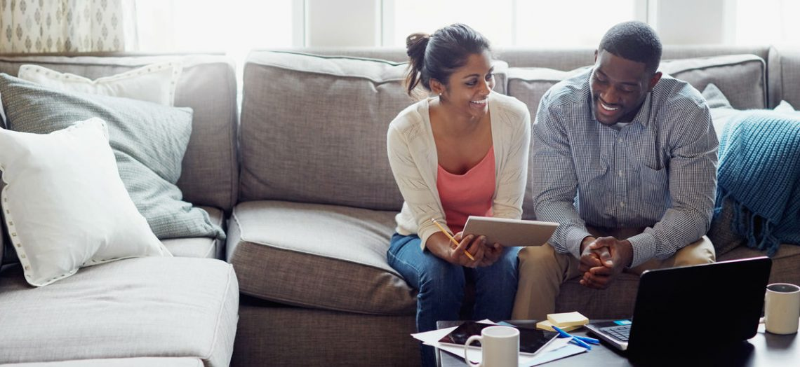Couple looking at a mortgage amortization schedule